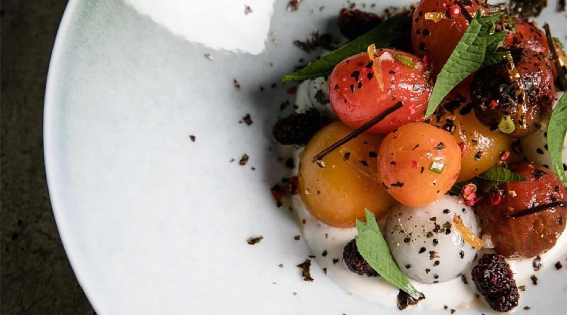 Chiang Mai Tomato Salad, served with Mulberries, candied Yuzu, dragon fruit and a house made almond ricotta. Photo Credit: Bunker.