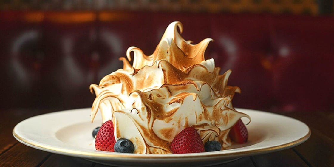 Bask in sweet nostalgia as you eat the Baked Alaska at Jimmy's Kitchen.