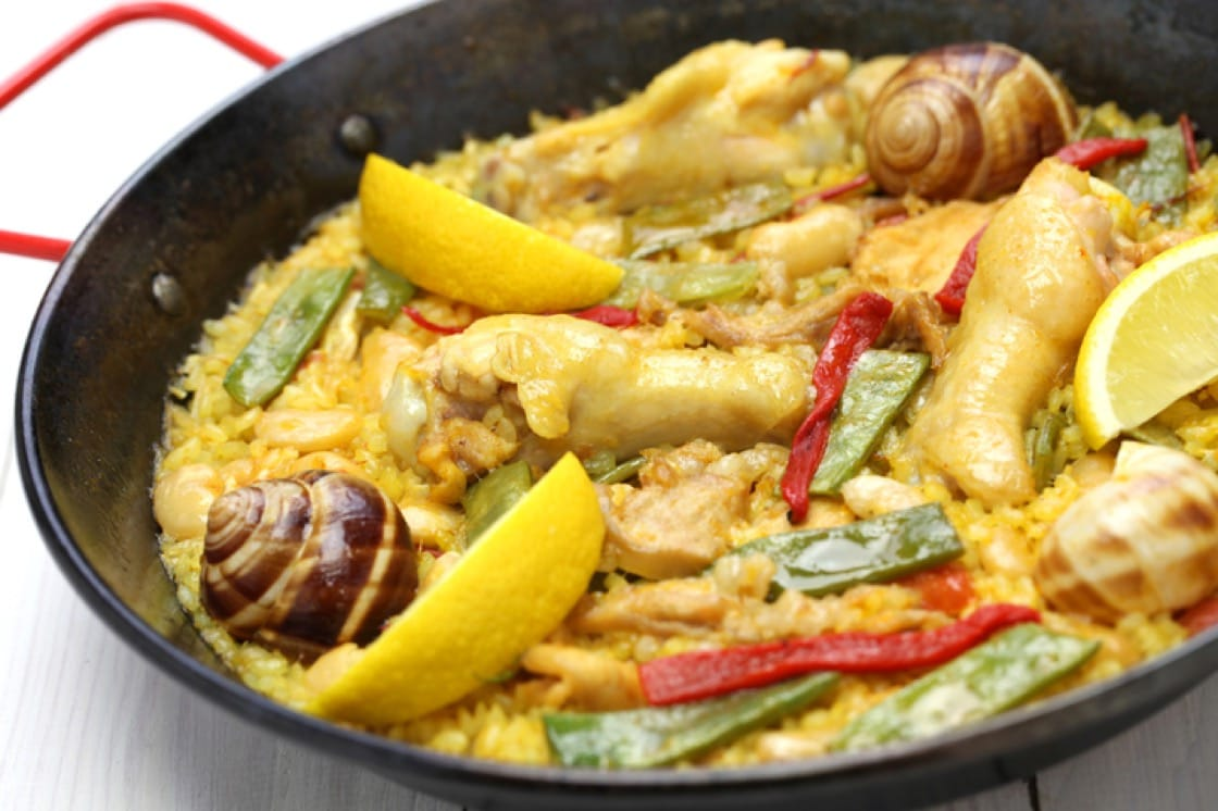Paella Valenciana is traditionally cooked with what's found in the forest: rabbit and snails.