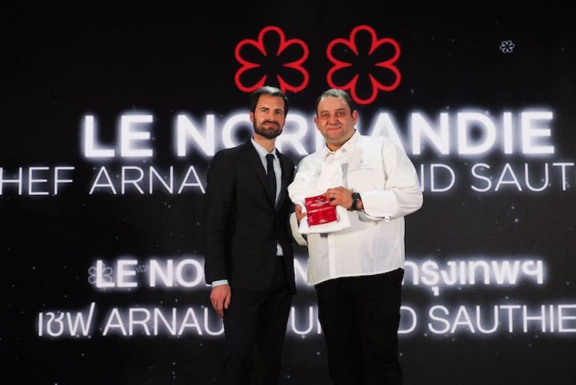 Chef Arnaud Dunand Sauthier with Gwendal Poullennec, International Director of The MICHELIN Guides, at the MICHELIN Guide Thailand 2019 Star Revelation announcement.  (Photo: Le Normandie Facebook page)