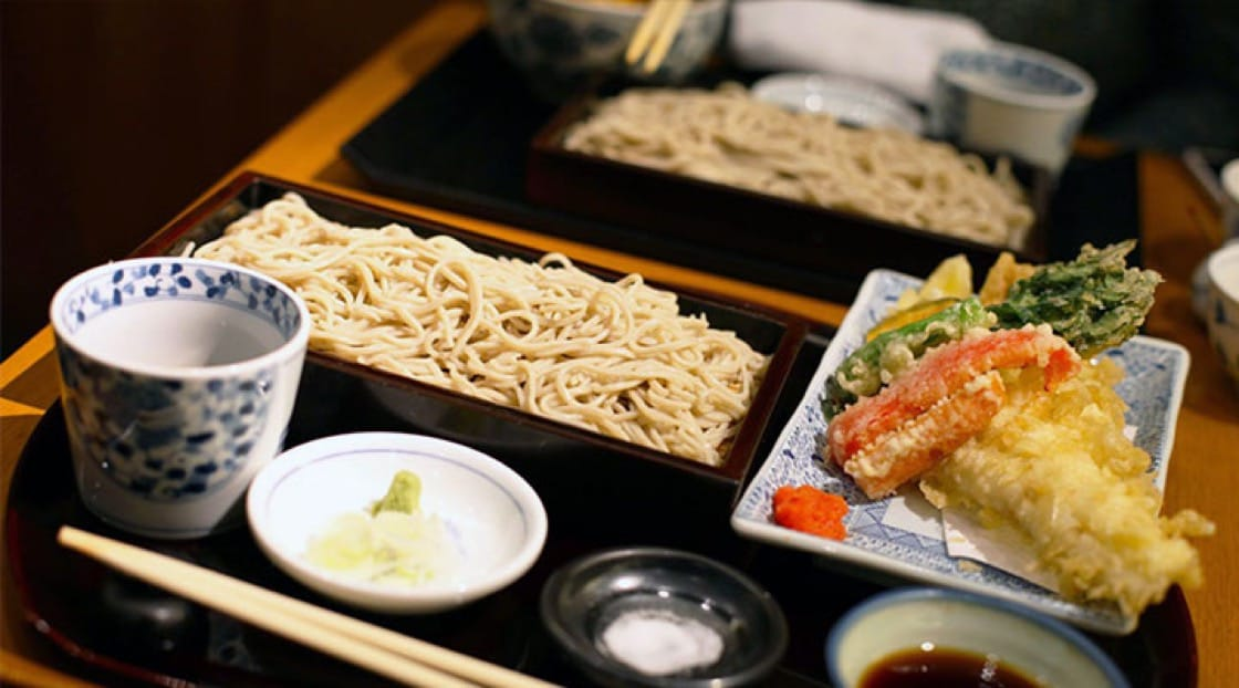Zaru soba, is a tray of cold soba, served with dipping sauce and side dishes.