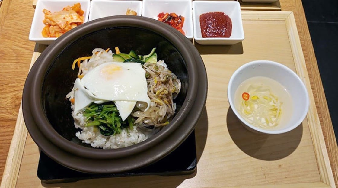 Bibimbap means 'mixed rice'  in Korean.