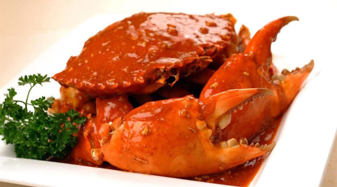 Singapore's unofficial national dish: chilli mud crab served with mantou.