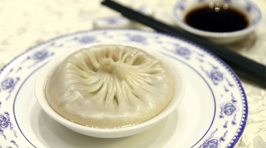 The traditional way to eat tang bao is to bite the bun open, release the filling and drink the soup with the spoon.