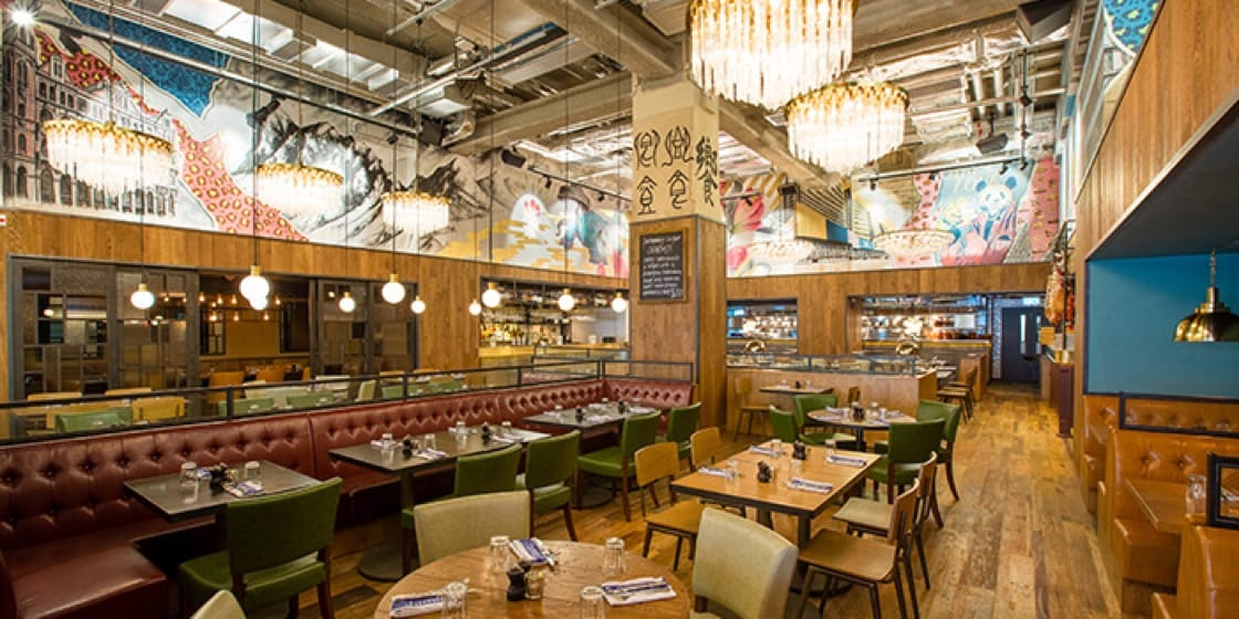 The unconventional décor at Jamie's Italian in Tsim Sha Tsui is exemplified by the history-themed graffiti.
