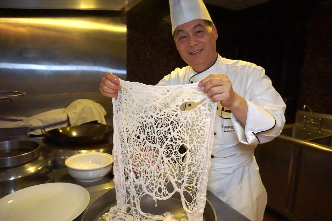 Leung Fai Hung, the executive Chinese chef of InterContinental Grand Stanford Hong Kong, explained that the caul fat is the fatty membrane between a pig's stomach and diaphragm. (Pic: Ada Au)
