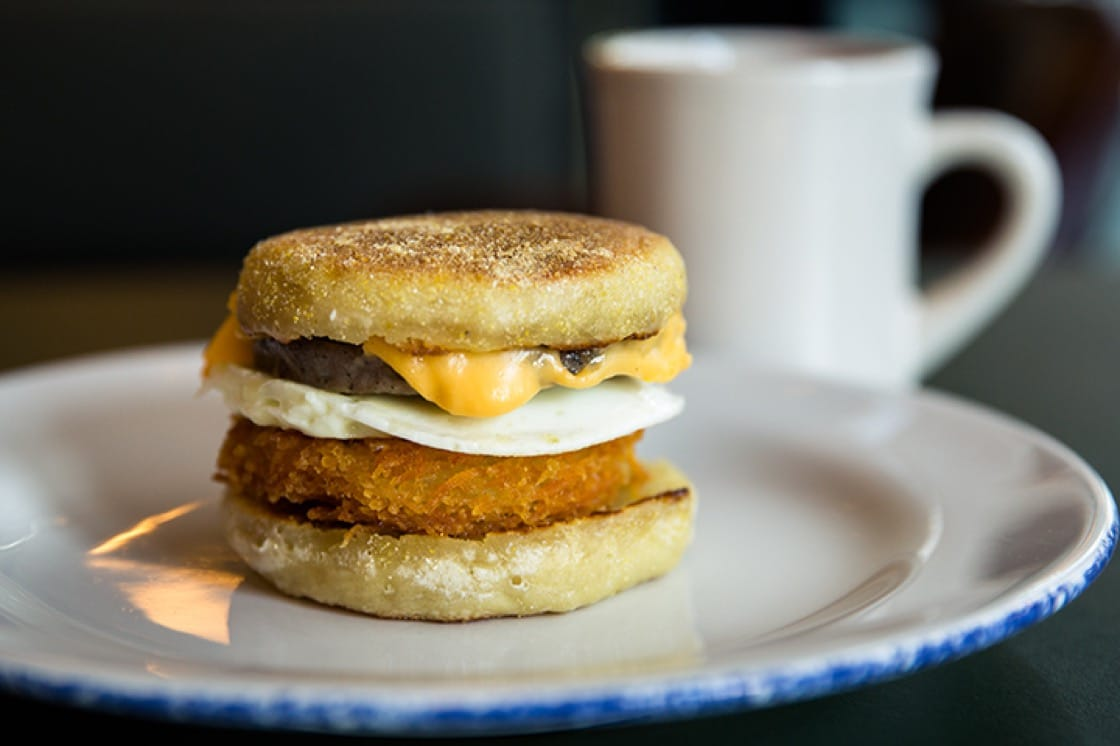"The ""Gas Station Sandwich"" featuring a house-made hashbrown with egg, cheese, sausage and grape jelly. (Photo courtesy of Ace Hotel Chicago.)"