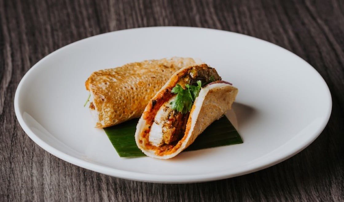 One of Thevar's chic tapas-style small plates is the Mackerel Dosai with Tomato Chutney. (Photo: Kenneth Goh)
