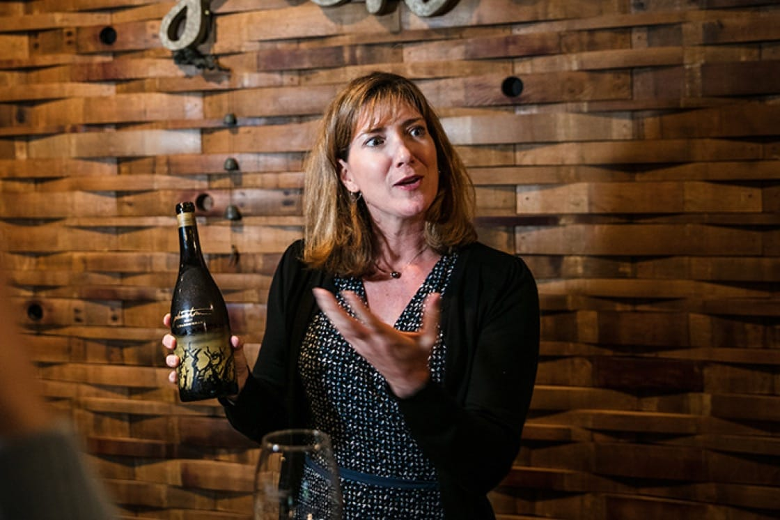 Jody Bogle, director of public relations, with a bottle of 2017 Phantom Chardonnay.