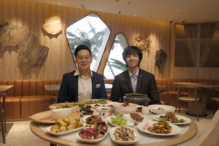 (from left) Mr Reuben Chua and Mr Tommy Lu of YUN NANS with dishes cooked with ingredients grown in the mountainous region of Yunnan in China.