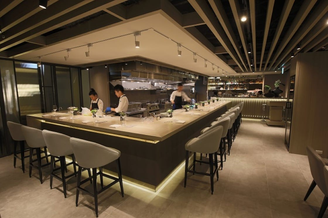 Ask to sit at the counter so you can watch the team prepare every course in front of your eyes in the expansive open kitchen. (Photo courtesy of Impromptu by Paul Lee.)
