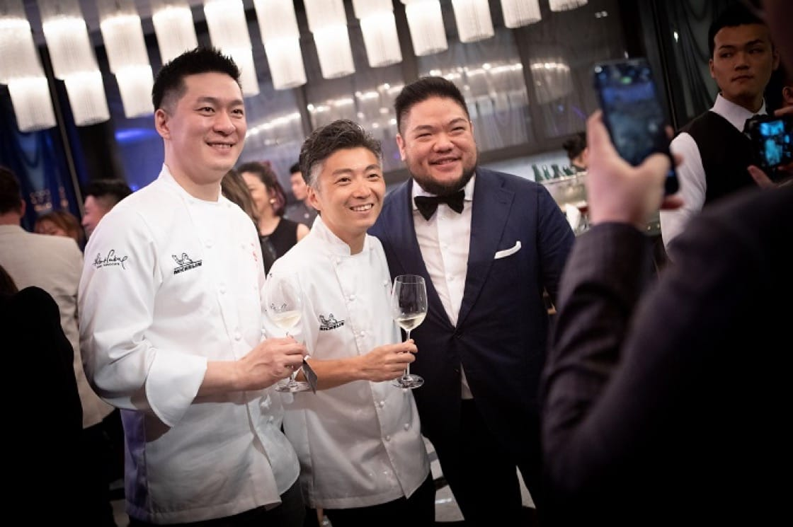 Chefs pose for photos with guests at the cocktail reception. From left: Paul Lee of newly-minted one-Michelin-starred Impromptu by Paul Lee and Richie Lin of one-starred MUME.