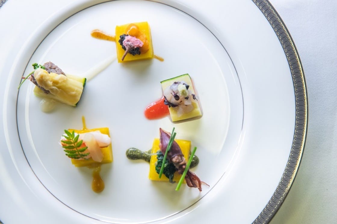 The dish by two-Michelin-starred Kashiwaya in Hong Kong was a springtime palette of grilled corn and zucchini, and five morsels of stewed shrimp, corned duck, caviar over sea urchin and firefly squid, each with its own specially created sauce.