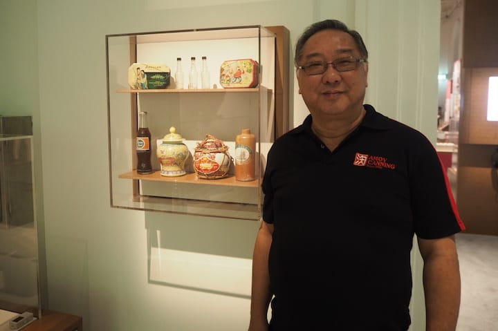 George Huang, managing director of Amoy Canning with the prized collection of food packaging from yesteryear. (Photo: Kenneth Goh)