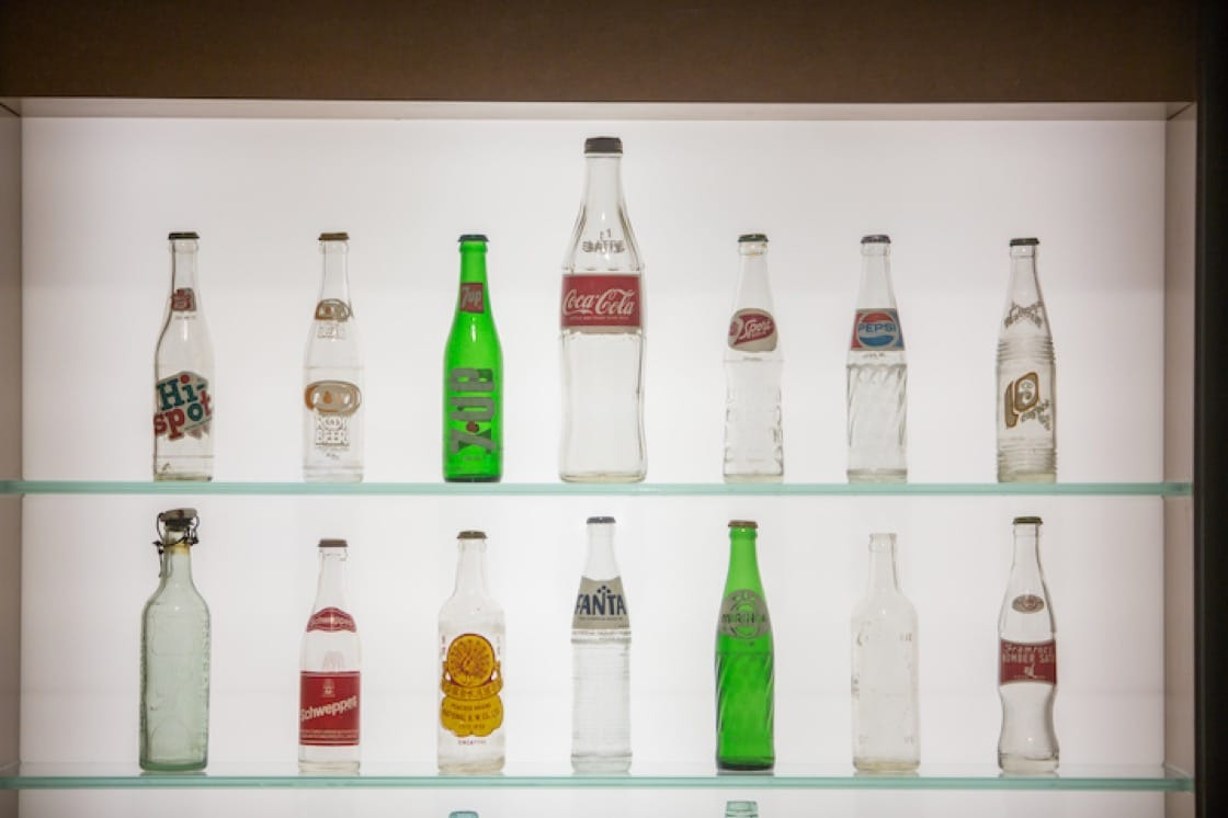 A wall showcase of local and international brands of beverages that were popular in Singapore in the 1960s and 1970s. (Photo: National Museum of Singapore)