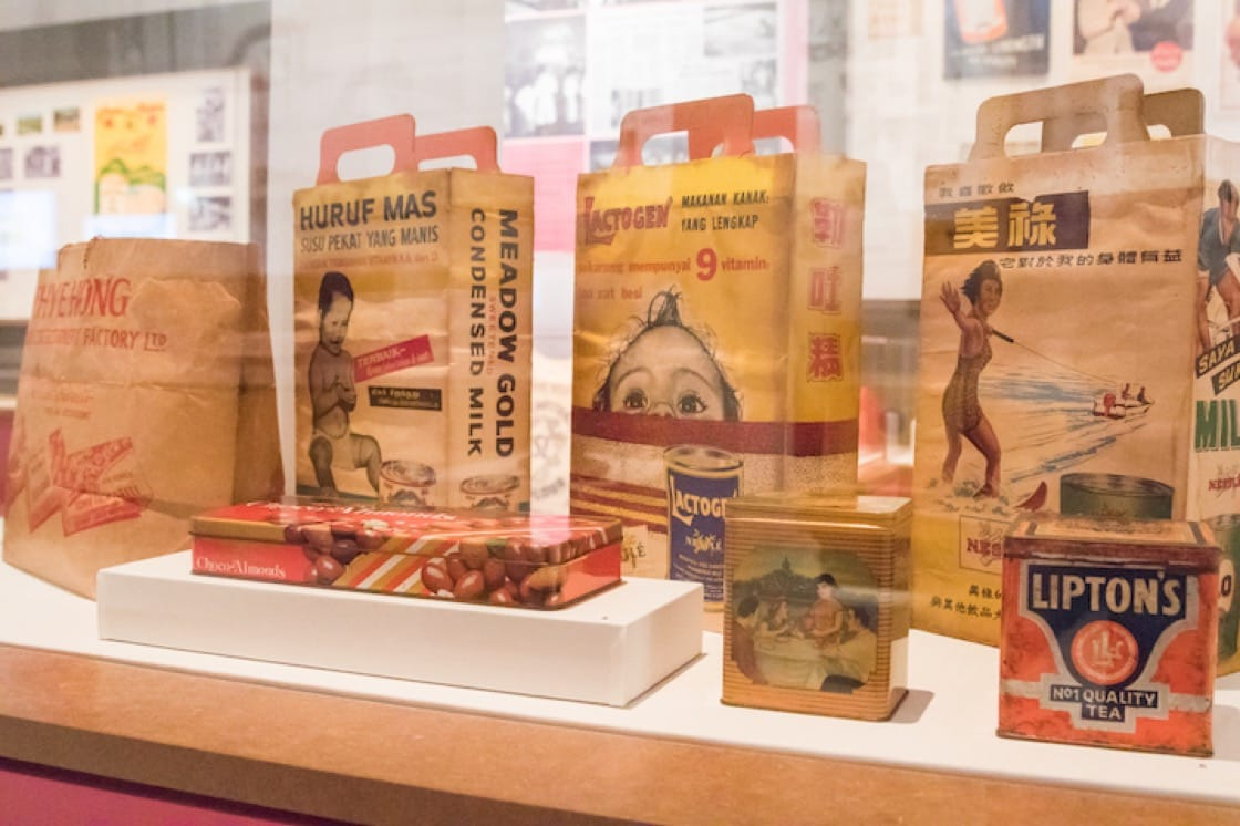 Paper bags advertising popular brands of powdered milk drinks – Meadow Gold condensed milk, Lactogen and Milo. (Photo: National Museum of Singapore)