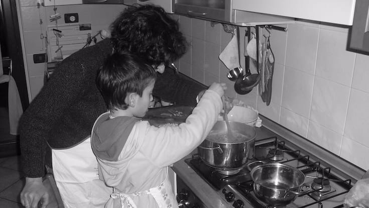 Galetti as a young boy, learning to cook with his mother (Pic: Roberto Galetti)