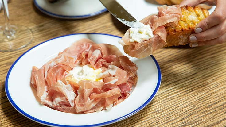 Burrata and prosciutto di Parma.