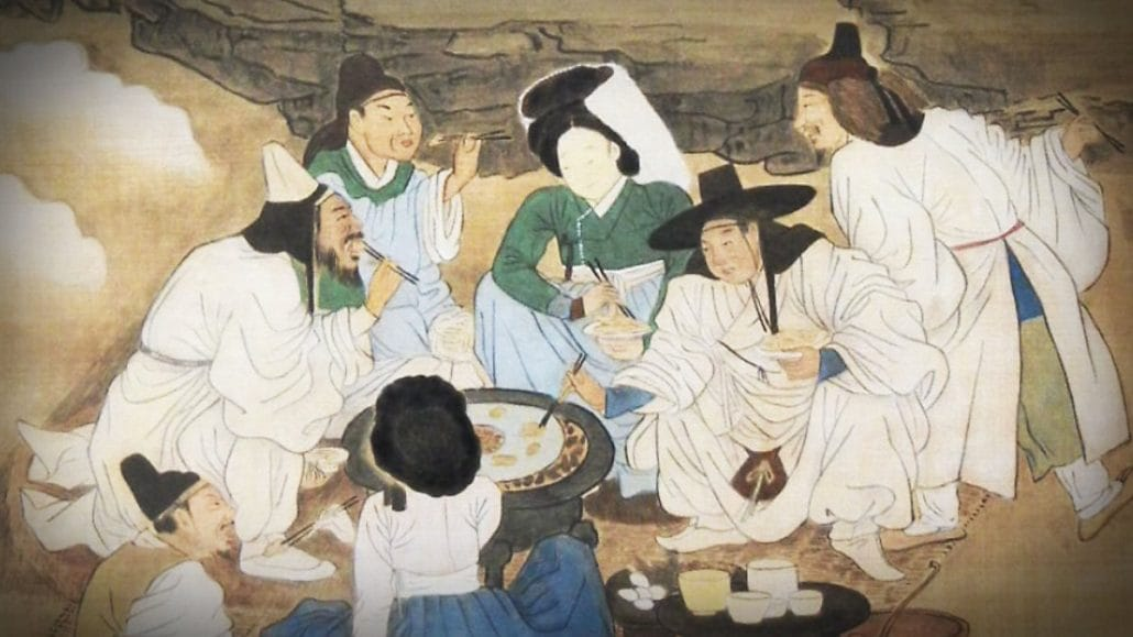 'Seolhuyayeon' by Joseon-period painter Kim Hong-do depicts five scholars and two courtesans gathered around a charcoal brazier grilling meat on a winter day.