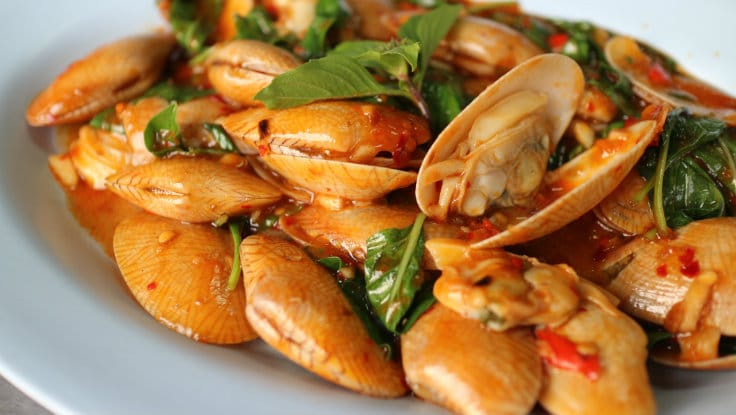 Stir-fried baby clams with roasted chilli paste.