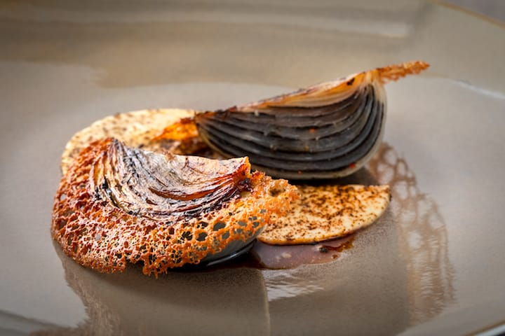 For one of ÉPURE's signature dishes, Cévennes Onion, Black Truffle, chef Boutin slathers black truffle on each layer of the roasted onion. (Photo:ÉPURE)