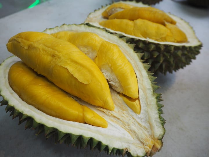 Look out for the colour and texture of the durian flesh after the durian seller has plied it open for you. (Photo: Kenneth Goh)