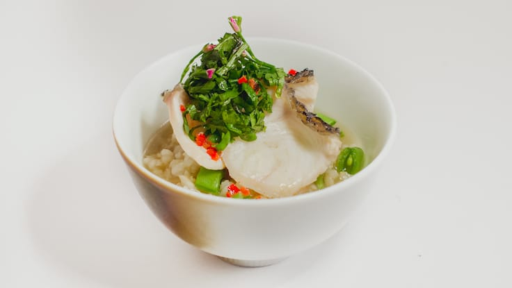 Kausmo's post-main course is a comforting Asian-style congee, made with the available greens and catch of the day (Pic: Kausmo)
