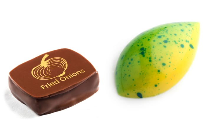 The Chocolate Line offers chocolates of different unconventional flavour combinations, including Cebolla (left — almond praline with fried onion), and Brazil (right — white chocolate ganache with cilantro, chilli pepper, cachaçarum and a jelly of lime) (Pic: The Chocolate Line)