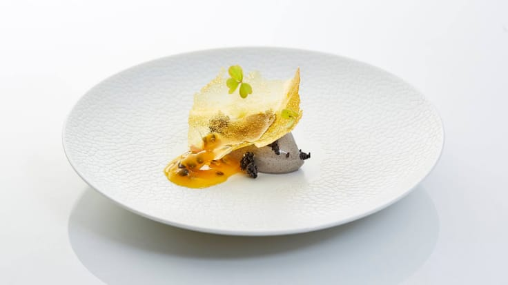 Black sesame crème glacée with passion fruit. Photo courtesy of Mezzaluna Restaurant