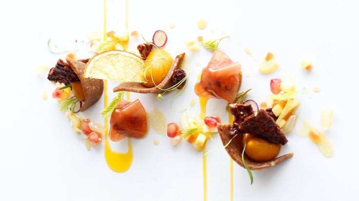 Blood orange. Amerigo Sesti's cuisine combines French cooking techniques and Thai ingredients. Photo courtesy of J'AIME by Jean-Michel Lorain.