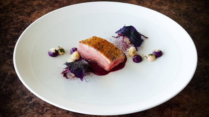 Canard Challandais, featuring with Roasted Challans Duck, red cabbage and walnut. Photo courtesy of Le Normandie