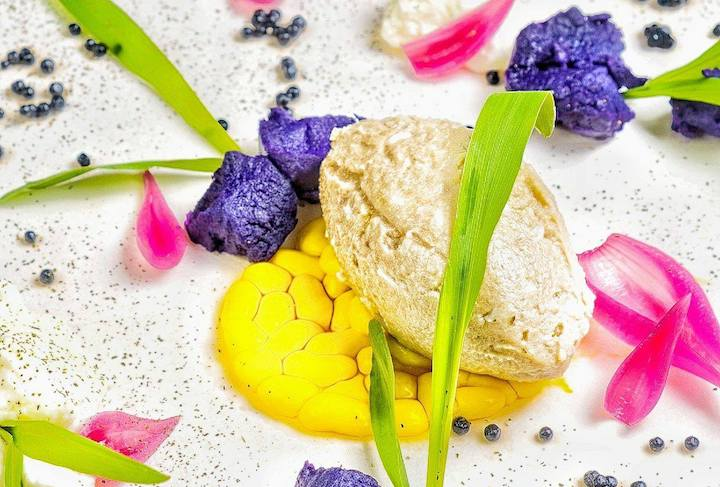 Herring pate jazzed up with a splash of colours from edible flowers.