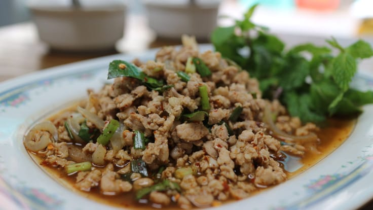 <i>Larb Moo</i> (minced pork mixed with Thai spicy sauce).