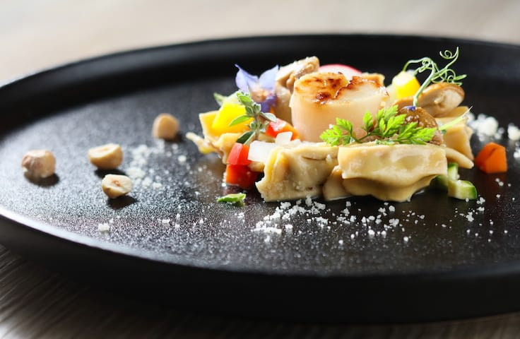 Small Ravioli filled with meat, mushroom sauce, seared scallop and hazelnut