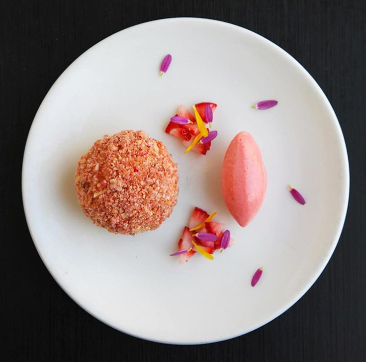White chocolate mousse, almond, lemon verbena and strawberry sorbet is currently offered on Blackbird's prix fixe lunch menu. (Photo courtesy of Blackbird.)