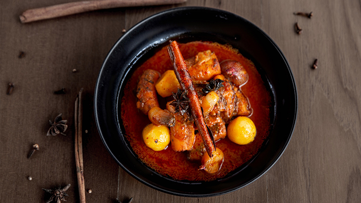 <i>Massaman Plamuek</i> (Braised Octopus in Massaman Curry). Photo courtesy of Seafood at Trisara.