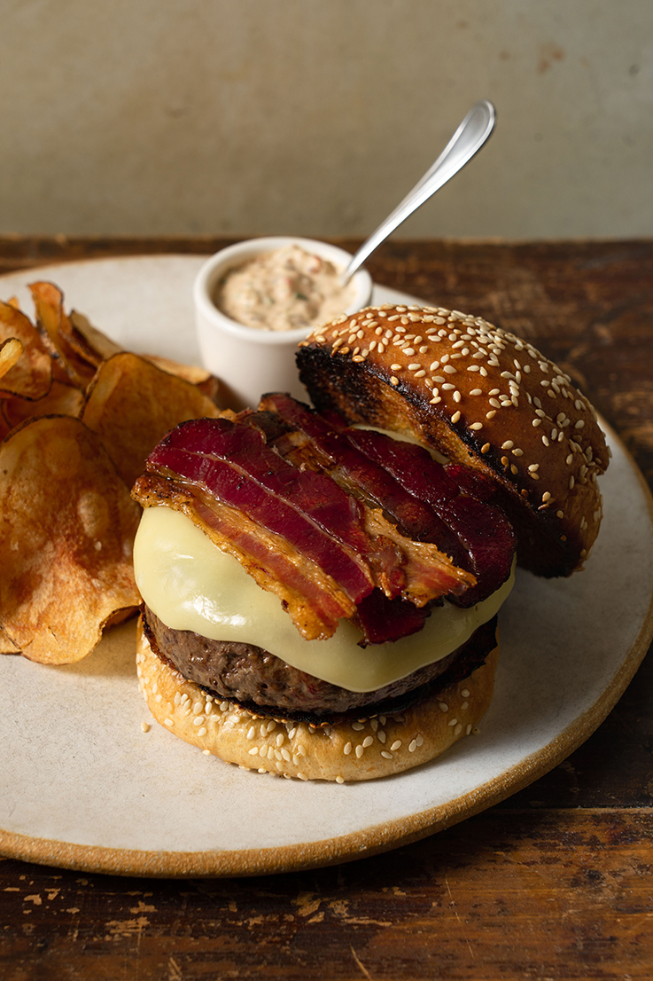 The famous burger at Gramercy Tavern is topped with cheddar cheese and bacon. (Photo by Giada Paoloni.)