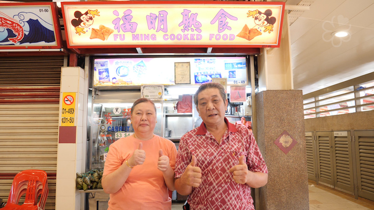 Goh and his wife, Lim Chin Hong, in front of Fu Ming's iconic Mickey Mouse signboard (Pic: MICHELIN Guide Digital)