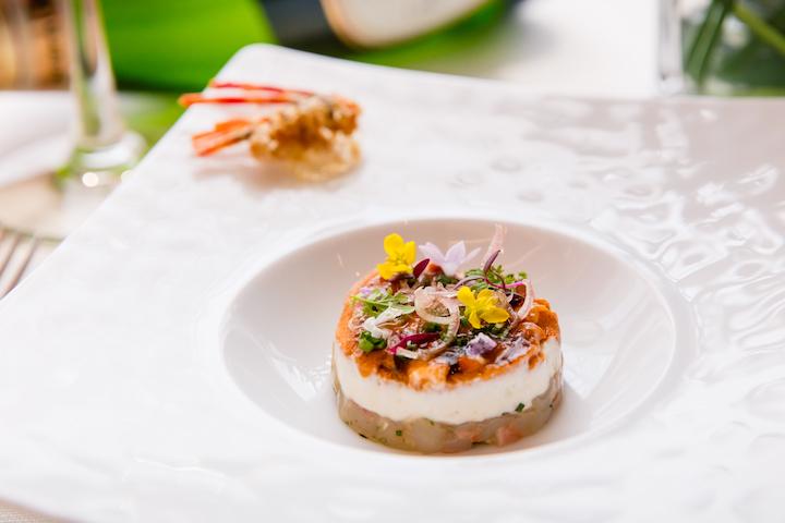 Chef Daisuke Mori presents a multi-faceted seafood dish, Hokkaido Sea Urchin & Botan Ebi. (Photo: Resorts World Sentosa)