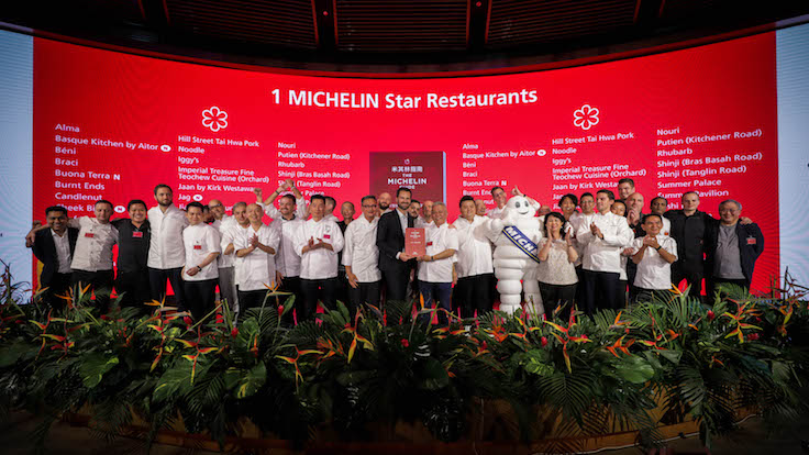 Representatives of one-MICHELIN-starred restaurants on stage with Poullennec and the Bibendum mascot.