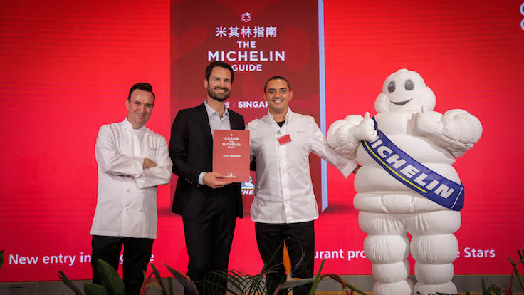 Singapore welcomes two new three-MICHELIN-starred restaurants, Les Amis and Odette, which were promoted from two to three stars this year. Pictured on the right and left of Poullennec are Sebastien Lepinoy and Julien Royer.