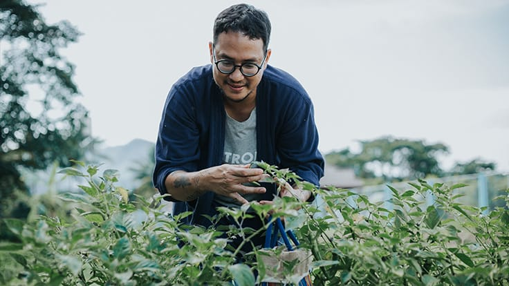 Chef Black Bulsuwan foraging fresh ingredients for his kitchen.