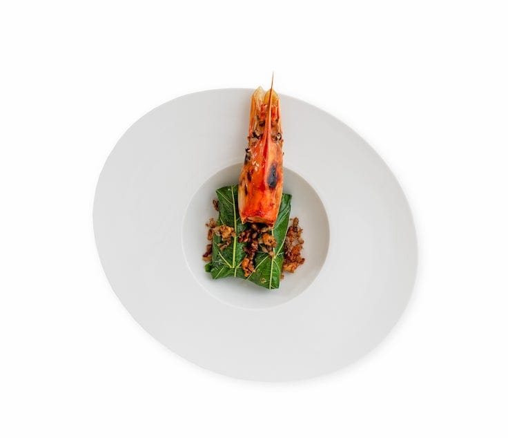 One of Paste's signature dishes: Grilled River Prawn Wrapped in Mulberry Leaves with Northern Mah Kwan Pepper and Ant Eggs (Pic: Paste)