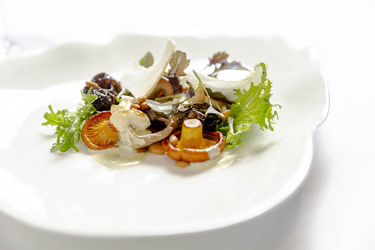 Foraged mushrooms, mustard frills and pine nut emulsion. (Photo by Mark Abramson.)