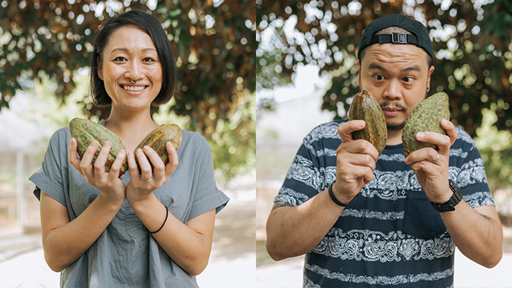 Chef Saki and Chef Joe having fun with cacao pods.