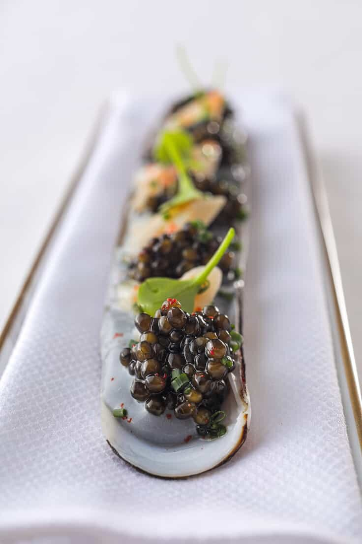 In the razor clam dish Le Kristal Kaviari at restaurant L'Envol, the dark sauce at the bottom is made with pressed caviar. (Pic: L'Envol)