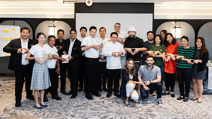 "Guest chefs, the Marriott Surawongse team, Michelin team and LightBlue team are doing the ""pyramid"" as a sign of commitment to aim for Zero Food Waste to Landfill."