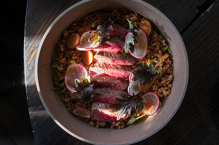 Imperial wagyu featuring beef fat-fried rice, soy-pickled garlic and radish. (Photo by Cassandra Wang.)