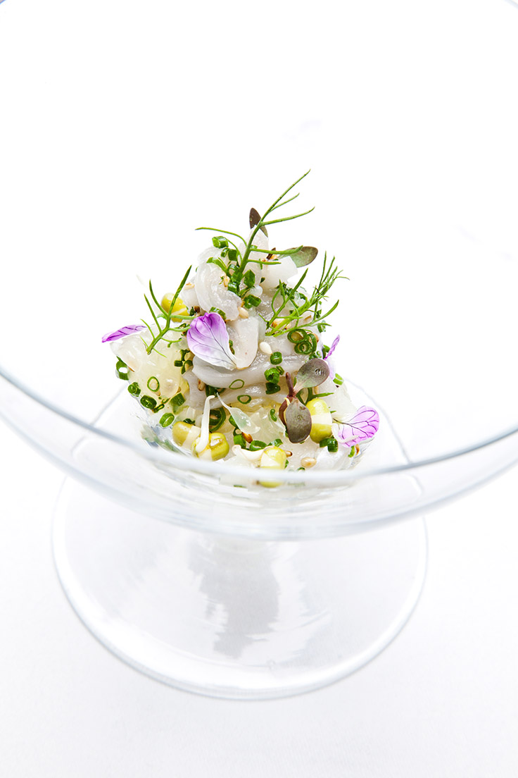 Engawa (fluke fin) sashimi with sprouted mung bean, radish blossom and oro blanco.