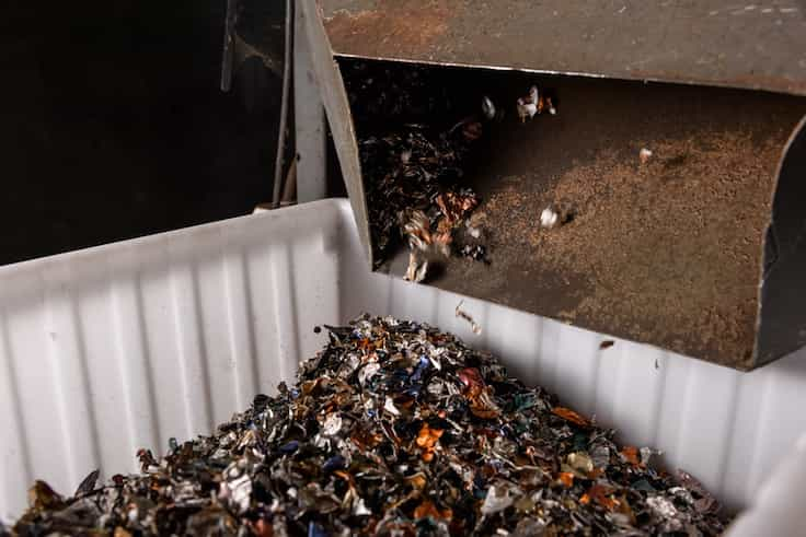 Coffee grounds and used aluminium capsules are being separated at a local plant in Hong Kong as part of Nespresso's recycling process. (Pic: Nespresso)